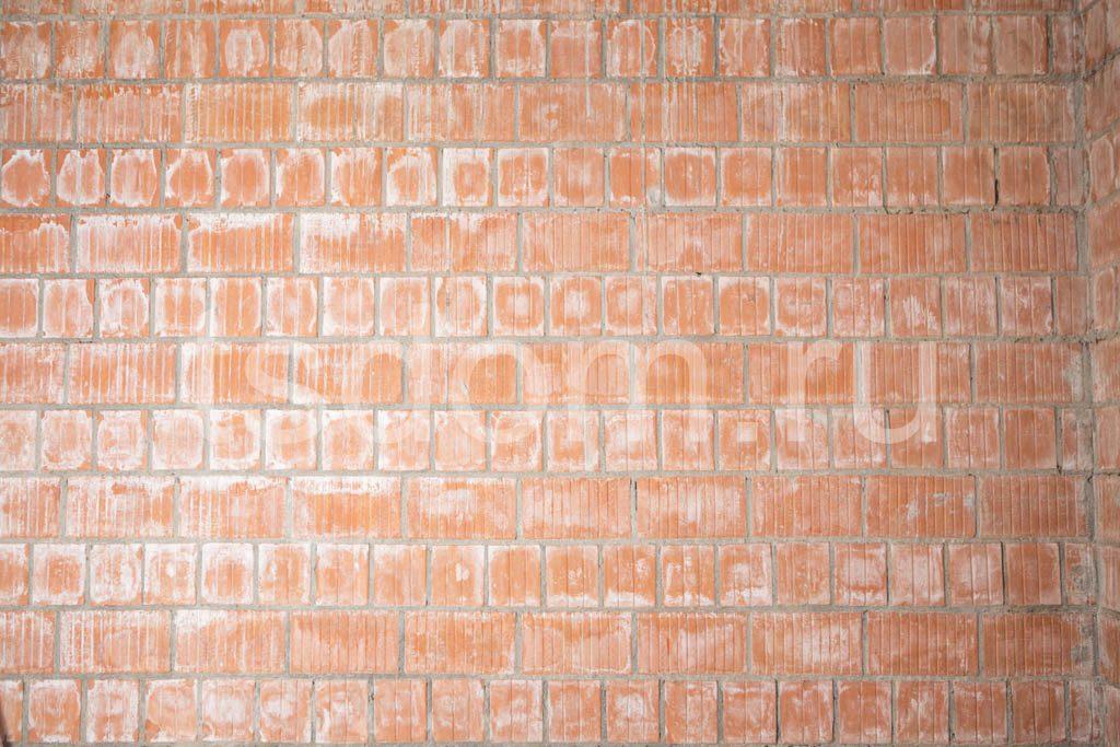 Кирпичная стена. Кладка рифленым кирпичом